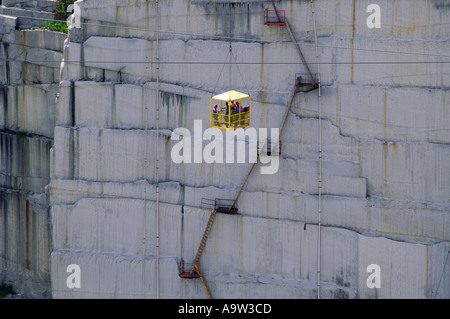 The Rock of Ages quarry at Barre, Vermont, USA. The worlds largest granite quarry. Workers lowered in cage down - Stock Photo