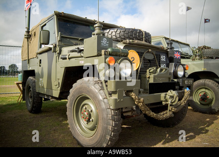 military vechical land rover off roader road 4 four wheel drive army fight war camo camoflage mud grip go anywhere - Stock Photo