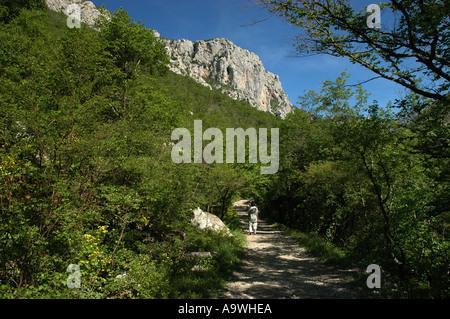 Hiking in Paklenica national Perk Limestone karst rock formations Velebit Mountain range Croatia Model released - Stock Photo