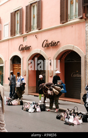 cartier designer 1qqy  Counterfeit fake designer handbags on sale outside the Cartier shop in  Rome Italy