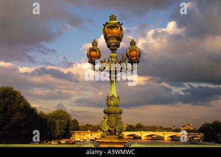 Paris The River Seine Pont Alexandre III Lamppost  Dramatic Sky France - Stock Photo