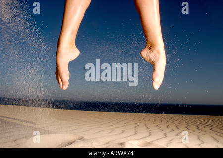 Feet in mid-air. - Stock Photo