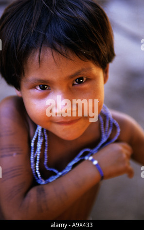 Koatinemo village, Brazil. Young Assurini Indian girl with blue bead necklace. Para State. - Stock Photo