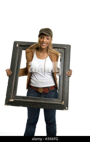 Pretty young black woman posing with a picture frame - Stock Photo