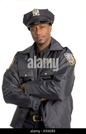 Young black police officer looking at the camera in the USA - Stock Photo