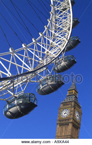 Tourists visit London Eye on the river Thames on a summers day with a clear blue sky - Stock Photo
