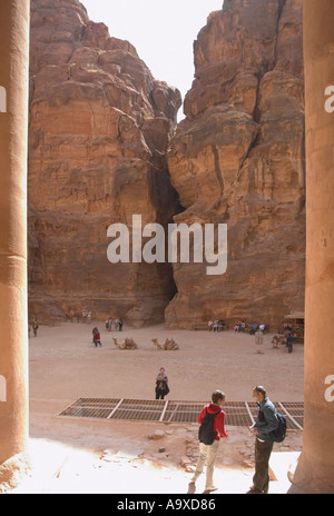 The view of the Siq from the Treasury Petra in front of the tomb are the new excavations containing the tombs found - Stock Photo