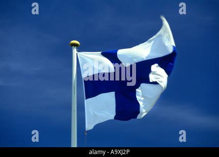 FLAG FINLAND FLYING ON FLAGPOLE - Stock Photo