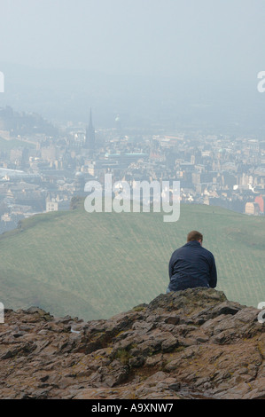 Walker resting on top of Arthurs seat, Edinburgh, Scotland U.K - Stock Photo