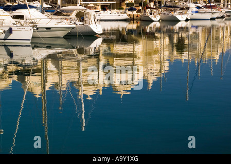 Reflections of the boats and apartments in the still waters of the marina at Puerto de Benalmádena - Stock Photo