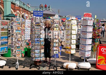 Seaside postcards for sale on promenade. Brighton, England - Stock Photo