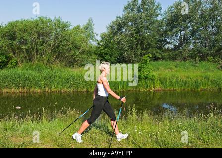 Personal trainer Sabine John at the beach of Heringsdorf, Usedom island, Mecklenburg Western Pomerania, Germany, - Stock Photo