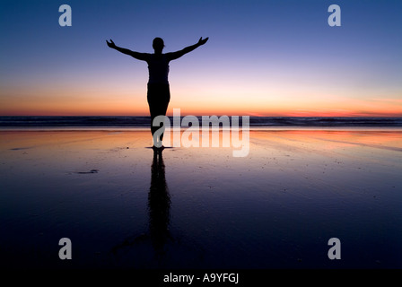 Silhouette of a woman at the beach at sunset, Cable Beach, Australia - Stock Photo