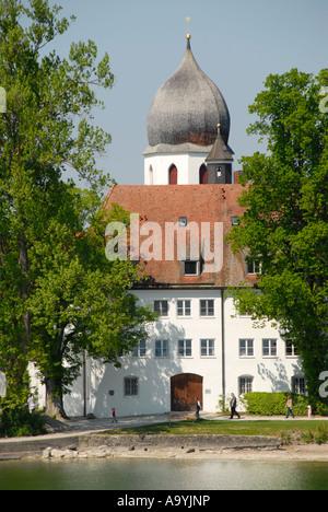 Baroque church tower of Frauenwoerth monastery Frauenchiemsee Fraueninsel Chiemsee Bavaria Germany - Stock Photo