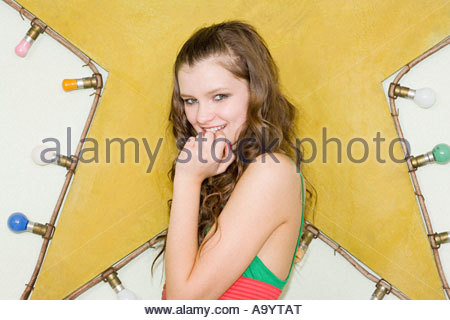 Girl standing near a star - Stock Photo
