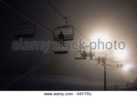 Skiers on a ski lifts - Stock Photo