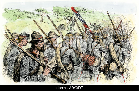 Confederate troops on the march  during the American Civil War. Hand-colored woodcut - Stock Photo