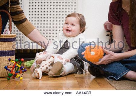 Baby girl playing - Stock Photo