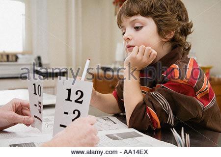 Boy learning mathematics - Stock Photo