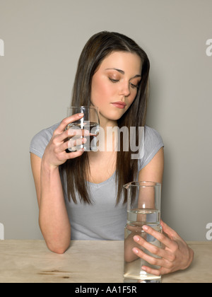 Young woman with water - Stock Photo