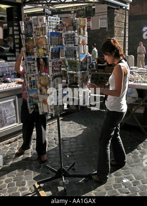 Tourist buying postcards on St Peter s square Rome Italy - Stock Photo