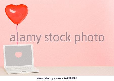 Balloon and laptop - Stock Photo
