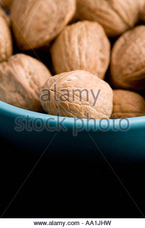 Walnuts in a bowl - Stock Photo