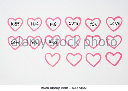 Love hearts and words painted on wall - Stock Photo