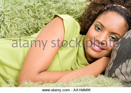 Woman reclining on arm chair - Stock Photo