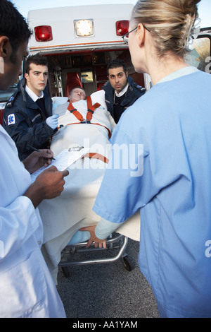 Paramedics and Doctors with Patient on Stretcher