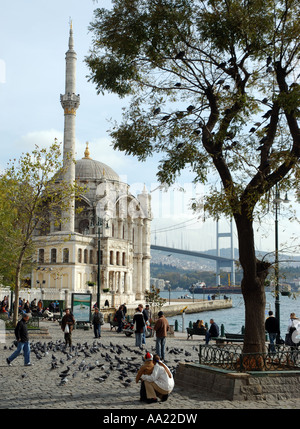 Ortakoy mosque with suspended bridge in background turkey istanbul - Stock Photo