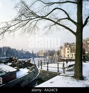 River Amstel looking towards Munttoren in the winter, Amsterdam, Netherlands - Stock Photo