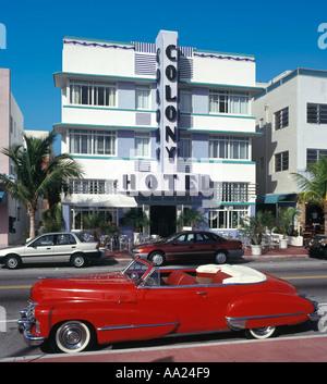 Vintage Car outside the art deco Colony Hotel, Ocean Drive, South Beach, Miami Beach, FL, USA - Stock Photo