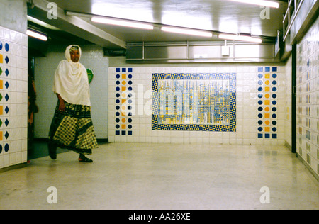 France, Paris, woman wearing traditional hijab walking in underpass - Stock Photo