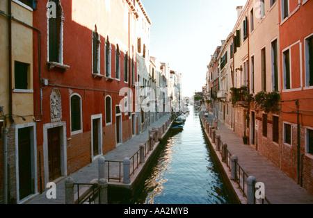 Italy, Venice, narrow canals Dorsoduro quarter, stone colored buildings facing across canal, doors and windows