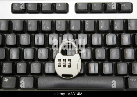 A combination lock on a keyboard representing Internet security. - Stock Photo