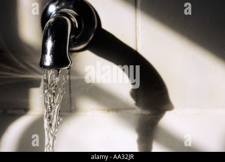 Running Water from Faucet in Bathroom - Stock Photo