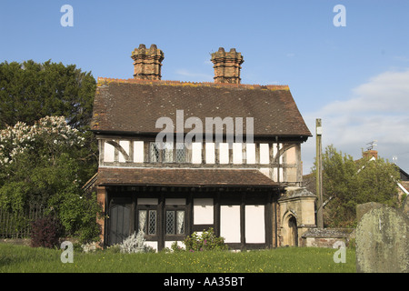 Half timbered house Dunster church house Somerset UK May - Stock Photo