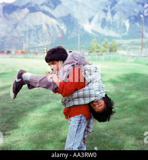 Canadian First Nation Interior Salish boys playing outside in a park Lillooet British Columbia Canada  KATHY DEWITT - Stock Photo