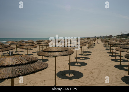 Parasols on the beach in Rimini Northern Italy - Stock Photo