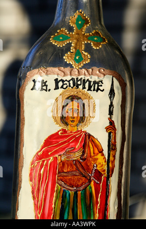 hand painted bottle containing rakija plum brandy given to guest on special occasions motif on bottle is an image - Stock Photo