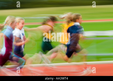 Children competing in school athletics - Stock Photo