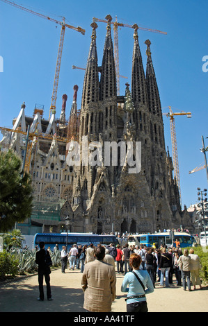 Tourists standing in front of the Sagrada Familia, Church of the Holy Family, architect Antoni Gaudo, Cathedral, - Stock Photo