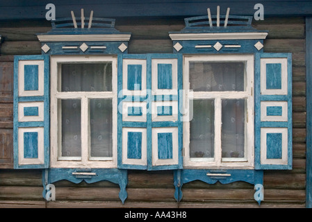 Windows with Ornamentic frames at different old Sibirian Wooden Houses, Omsk at the Rivers of Irtisch and Omka, - Stock Photo