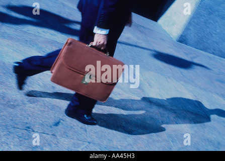 New York City Businessman Walking on the Street With a Briefcase - Stock Photo