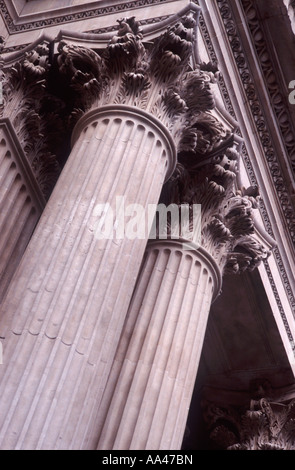 Corinthian order paired columns supporting portico on west main facade of St Paul's Cathedral, City of London, England - Stock Photo