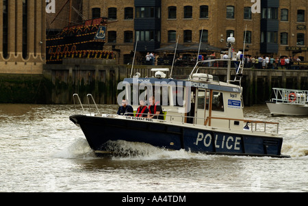 Police patrol boat the Sir Robert Peel on the River Thames London England UK - Stock Photo