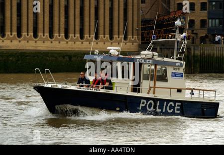 Police marine patrol boat River Thames London England Uk - Stock Photo