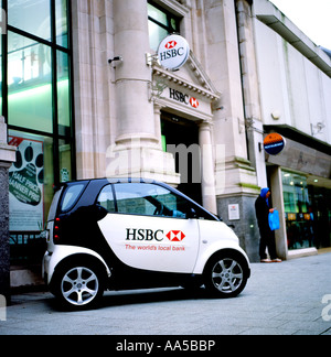 HSBC Smart Car with the banks logo parked outside Queen Street branch of the bank Cardiff Wales UK  KATHY DEWITT - Stock Photo