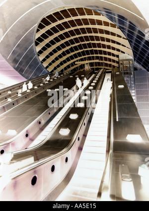 Canary Wharf London Underground Station Jubilee Line escalator entrance shown manipulated negative image  Isle of - Stock Photo